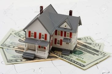 3466307-House-sitting-on-money-with-puzzle-Understanding-mortgages-Stock-Photo